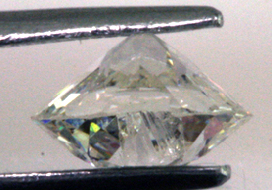 Chip on crown of .97 ct. Old European and thin girdle